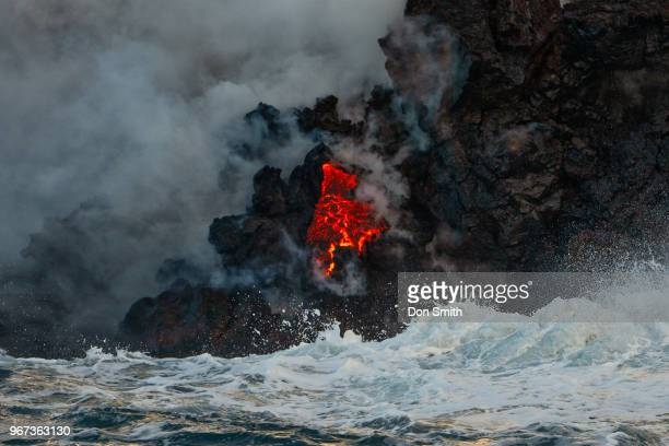 Lava from Kilauea Volcano flows into Pacific Ocean along Kapoho coast on the east side of Hawaii's Big Island on May 31 2018 Much of these flows are...