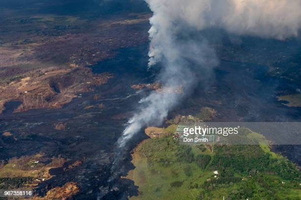 Lava from the Kilauea Volcano burns trees near a Geothermal Plant along the East Rift Zone which runs through Leilani Estates on the Big Island on...
