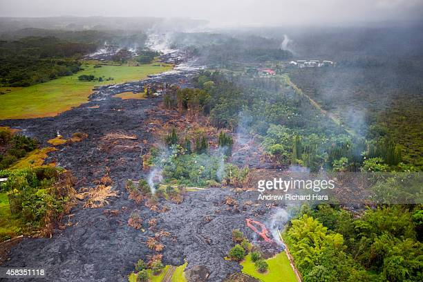 Lava from the Kilauea Volcano flows across the ground on November 3, 2014 in Pahoa, Hawaii. Molten rock from the flow is inching its way towards...
