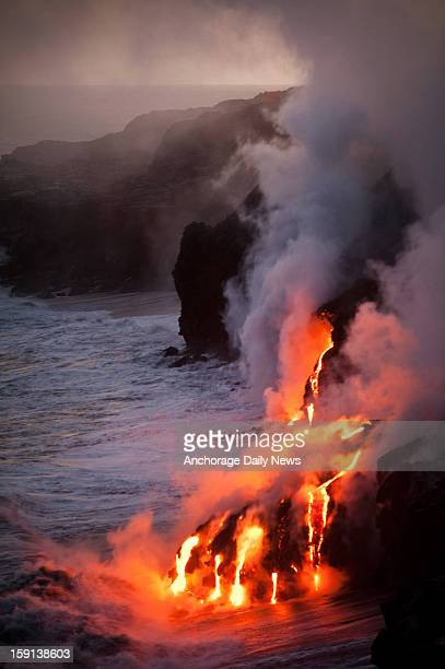 Lava from the Puu Oo cone of Kilauea Volcano reaches the Pacific Ocean on the southeastern coast of Hawaii Island Hawaii on Monday evening January 7...