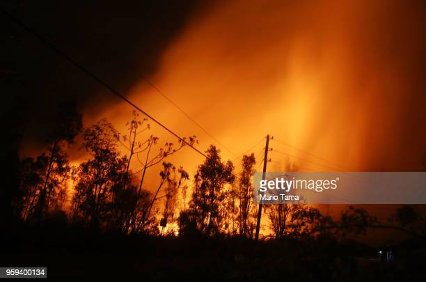 Lava illuminates volcanic gases from the Kilauea volcano at fissure 13 on Hawaii's Big Island on May 16 2018 in Hawaii Volcanoes National Park Hawaii...