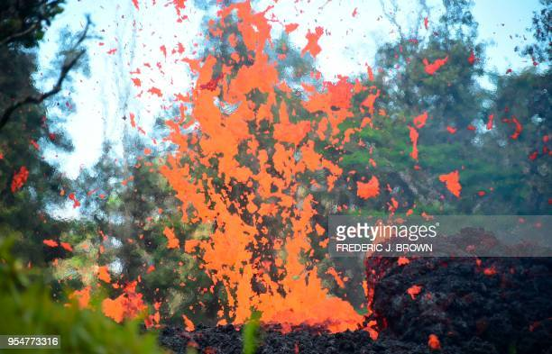 TOPSHOT Lava is seen coming from a fissure in Leilani Estates subdivision on Hawaii's Big Island on May 4 2018 Up to 10000 people have been asked to...