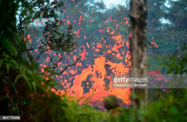 Lava is seen coming from a fissure in Leilani Estates subdivision on Hawaii's Big Island on May 4 2018 Up to 10000 people have been asked to leave...