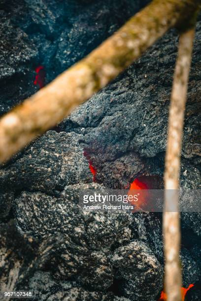 Lava is seen coming from a fissure on May 9 2018 in Leilani Estates Hawaii The first Hawaiian house was consumed this week by the monthslong...