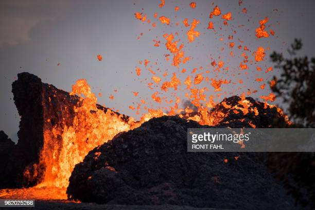 Lava lake forms in the Leilani Estates subdivision, situated in Kilauea's East Rift Zone in Hawaii on May 23, 2018 amid eruptions from the Kilauea...
