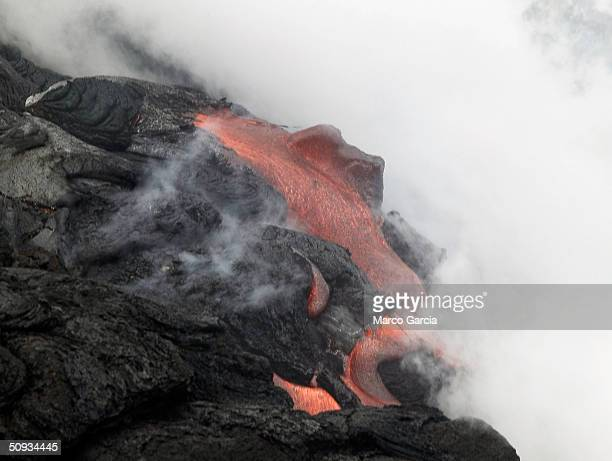 Lava pours into the ocean from Kilauea Volcano on June 6 2004 at Volcanoes National Park near Volcano Hawaii Lava from Kilauea has reached the ocean...