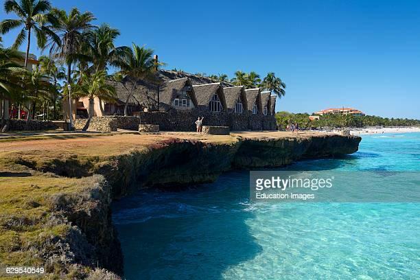 Lava rock shore and white sand beach at Varadero Cuba resort hotel