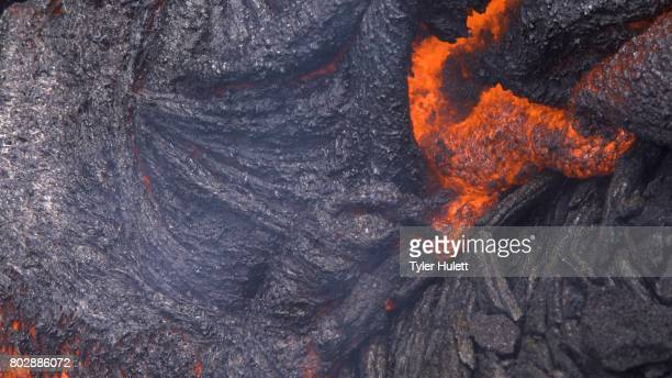 lava rolls in macro - pele goddess stock pictures, royalty-free photos & images