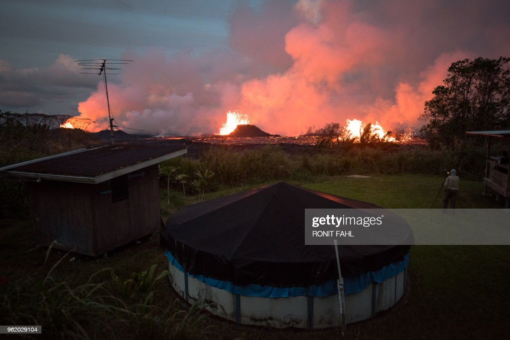 TOPSHOT - Lava spews in Kilauea's East Rift Zone in Pahoa, Hawaii amid eruptions from the Kilauea volcano. - Kilauea is one of the most active volcanoes in the world and one of five on the Big Island of Hawaii. It erupted May 3, forcing the evacuation of 2,000 people from their homes located on the mountain. Scientists believe volcanic activity may be a precursor to a major eruption, similar to one that occurred on the island in the mid-1920s.