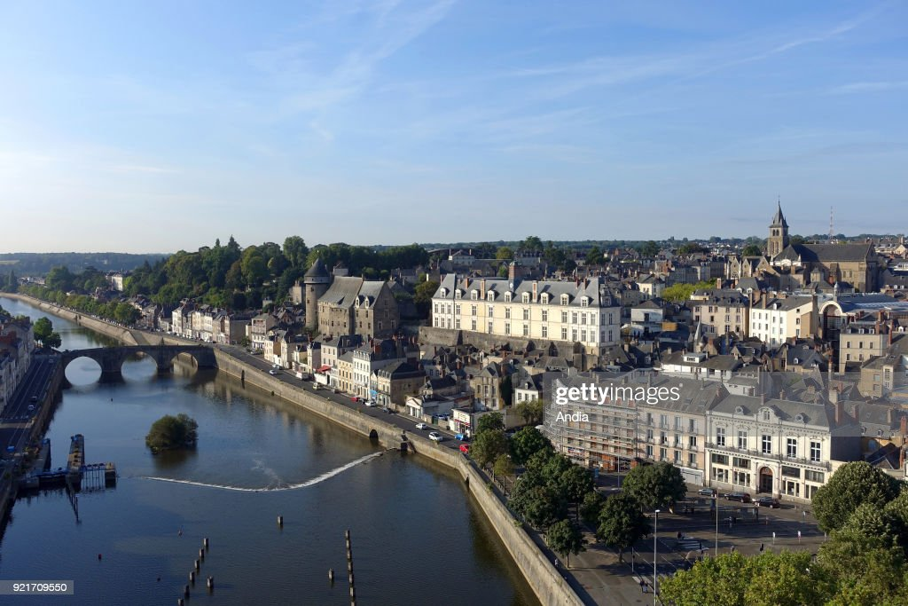 aerial view of the city centre with the chateau (castle) by the Mayenne river, the former Law Court building and the cathedral.