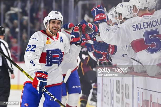 Laval Rocket center Alex Belzile celebrates his goal with his teammates at the bench during the Cleveland Monsters versus the Laval Rocket game on...