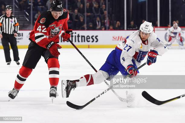 Laval Rocket center Alexandre Alain gains control of the puck over Binghamton Devils right wing Nathan Bastian during the Binghamton Devils versus...