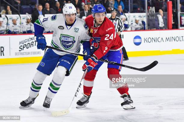 Laval Rocket center Daniel Audette and Utica Comets defenceman Patrick Wiercioch battle for position on the ice during the Utica Comets versus the...
