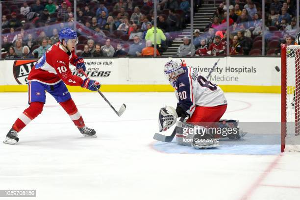 Laval Rocket center Jake Evans puts the puck past Cleveland Monsters goalie Matiss Kivlenieks for a goal during the first period the American Hockey...