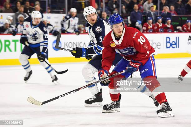 Laval Rocket center Jake Evans tracks the play on his left during the Manitoba Moose versus the Laval Rocket game on February 19 at Place Bell in...