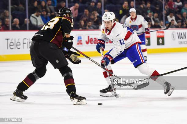 Laval Rocket center Lukas Vejdemo tries to skate around a defenceman during the Cleveland Monsters versus the Laval Rocket game on December 10 at...