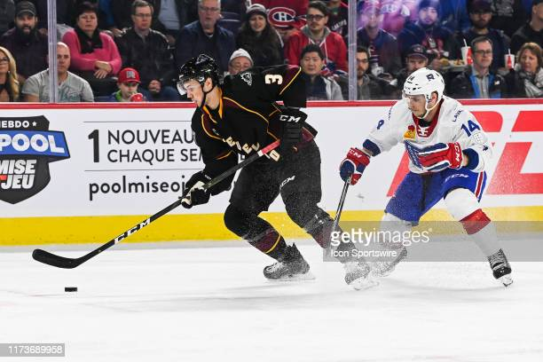 Laval Rocket center Matthew Peca tries to stop Cleveland Monsters defenceman Andrew Peeke during the Cleveland Monsters versus the Laval Rocket game...