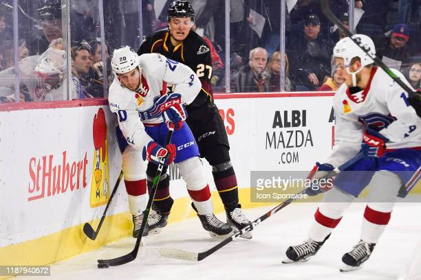 Laval Rocket defenceman Maxim Lamarche tries to maintain control of the puck during the Cleveland Monsters versus the Laval Rocket game on December...