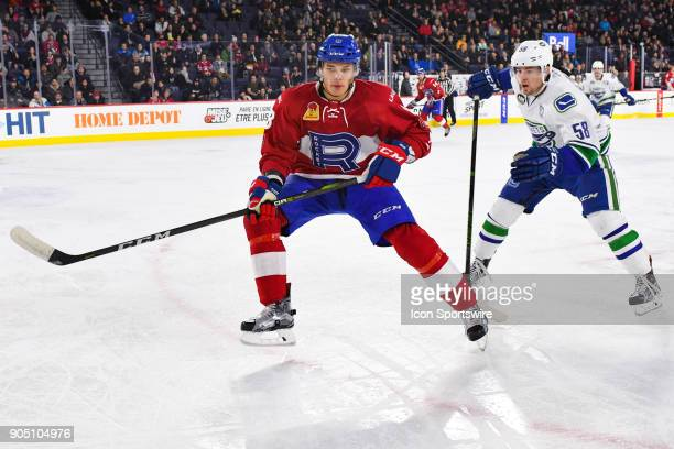 Laval Rocket defenceman Noah Juulsen gets to the corner of the ice before Utica Comets left wing Michael Carcone during the Utica Comets versus the...