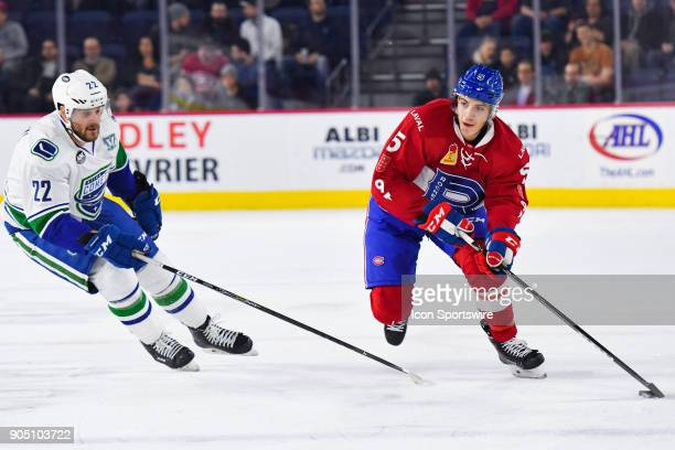 Laval Rocket defenceman Tom Parisi skates in control of the puck during the Utica Comets versus the Laval Rocket game on January 10 at Place Bell in...