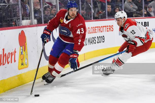 Laval Rocket defenceman Xavier Ouellet escapes Charlotte Checkers right wing Julien Gauthier with the puck during the Charlotte Checkers versus the...