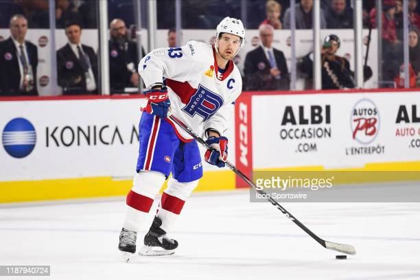 Laval Rocket defenceman Xavier Ouellet looks for a pass target during the Cleveland Monsters versus the Laval Rocket game on December 10 at Place...