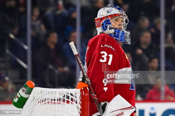 Laval Rocket goalie Cayden Primeau looks towards his right during the Toronto Marlies versus the Laval Rocket game on December 28 at Place Bell in...