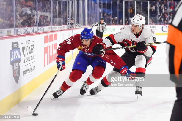Laval Rocket left wing Jordan Boucher and Belleville Senators defenceman Andreas Englund battle for the puck during the Belleville Senators versus...