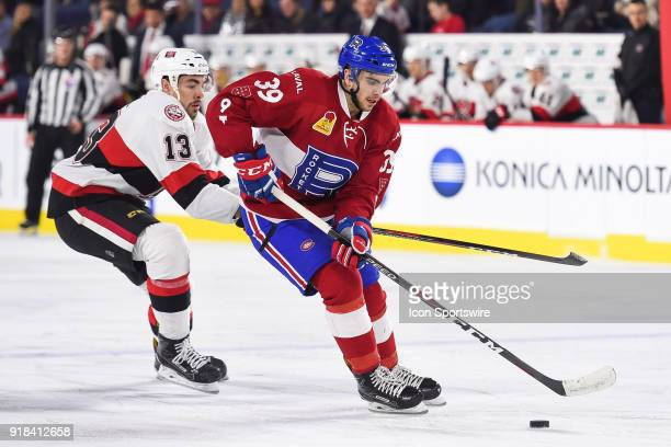 Laval Rocket left wing Jordan Boucher gains control of the puck over Belleville Senators left wing Nick Paul during the Belleville Senators versus...