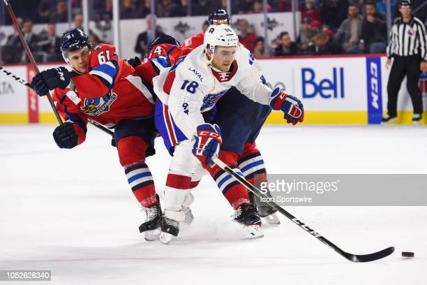 Laval Rocket left wing Kenny Agostino escapes Springfield Thunderbirds defenceman Riley Stillman and Springfield Thunderbirds defenceman Julian...