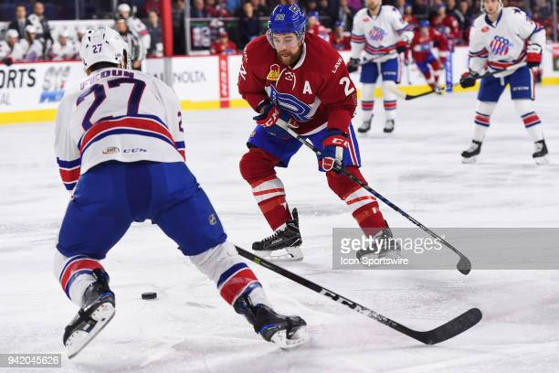 Laval Rocket right wing Chris Terry looses control of the puck in front of Rochester Americans defenceman Taylor Fedun during the Rochester Americans...