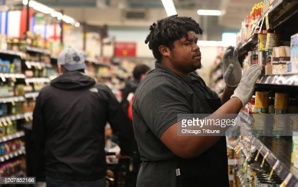 Lavance Fulton restocks shelves at Mariano's in Chicago's Bucktown neighborhood on March 19 amid the coronavirus pandemic.