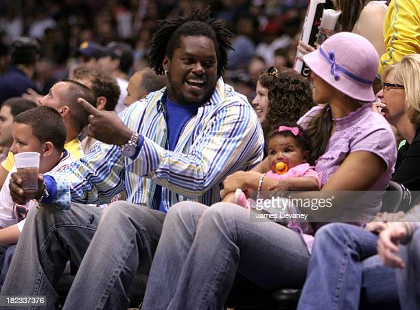 LaVar Arrington and Trishia Johnson with daughter during Celebrities Attend Miami Heat vs New Jersey Nets Playoff Game May 14 2006 at Continental...