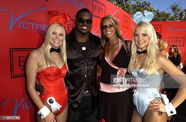 LaVar Arrington and Trishia Johnson with Playboy Playmates