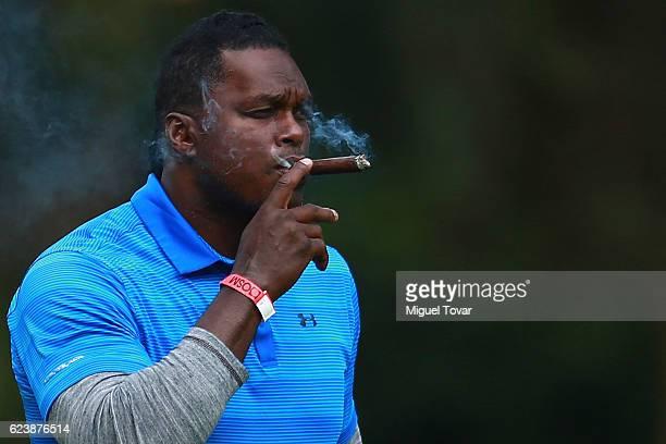 Lavar Arrington former NFL player smokes a cigar during the NFL Golf Legends Tournament at Club de Golf Mexico on November 17 2016 in Mexico City...
