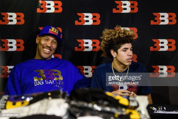 LaVar Ball father of basketball player LiAngelo Ball and the owner of the Big Baller brand sits with his other son LaMelo Ball during a promotional...