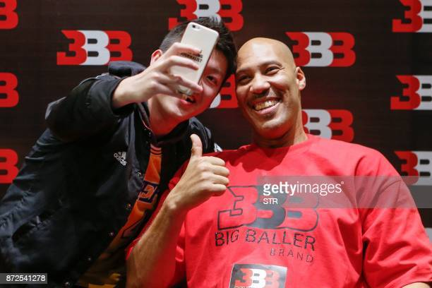 LaVar Ball father of LiAngelo Ball and the owner of the Big Baller brand poses for a selfie with a fan during a promotional event in Shanghai on...