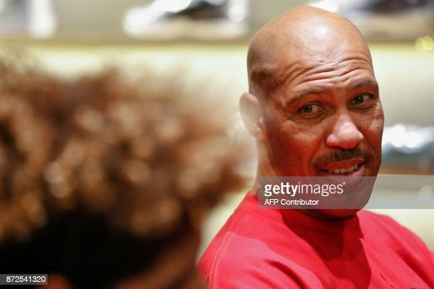LaVar Ball father of LiAngelo Ball and the owner of the Big Baller brand looks at his youngest son during a promotional event in Shanghai on November...
