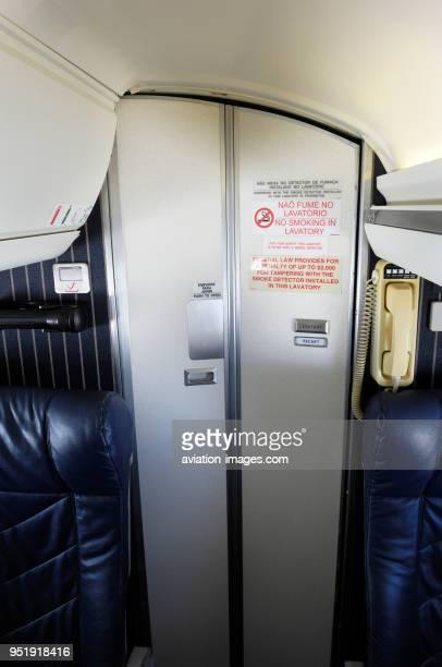 Lavatory door in the passenger cabin of Embraer ERJ135LR on flight ComandatubaGRU