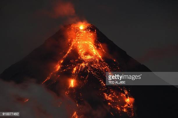 TOPSHOT Lave flows from Mayon volcano at it continues to erupt as seen from Legazpi in Albay province south of Manila on January 25 2018 Philippine...