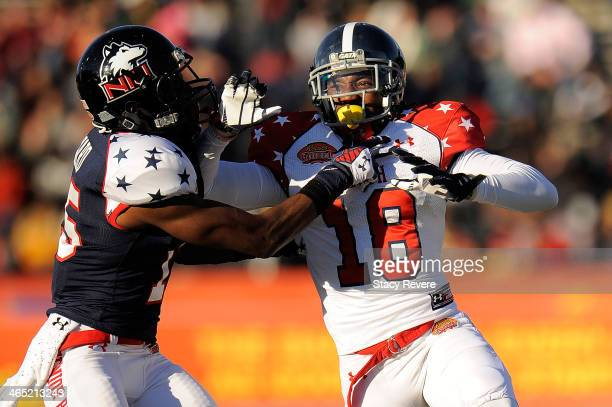 Lavelle Westbrooks of the South squad works against Jimmie Ward of the North squad during the Reese's Senior Bowl at Ladd Peebles Stadium on January...