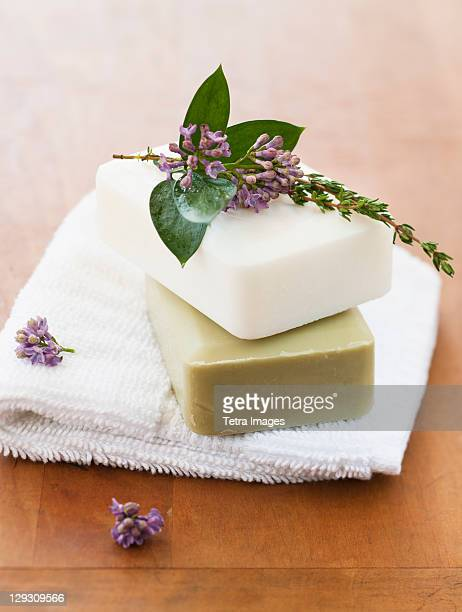 Lavender and soap bars on towel