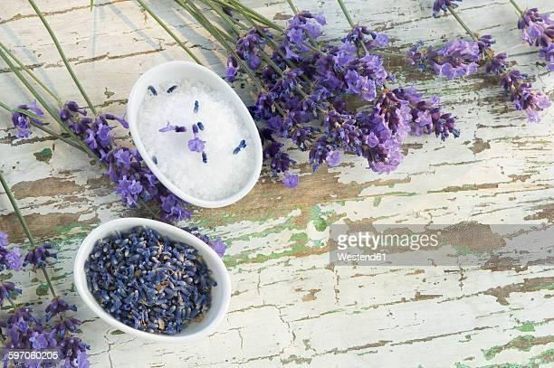 Lavender, bath salts and lavender soap in bowls, copy space