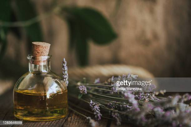 lavender essential oil - aromatherapy oil stock pictures, royalty-free photos & images