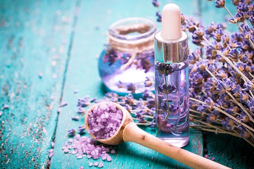 lavender flower,oil,salt, spa beauty concept. wood old background. 490716586