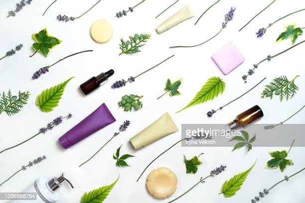 lavender flowers and beauty cosmetics products isolated on white background. - lavender color ストックフォトと画像