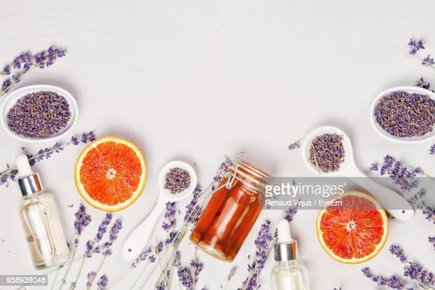 Lavender Flowers And Halved Blood Orange With Spoons Over White Background