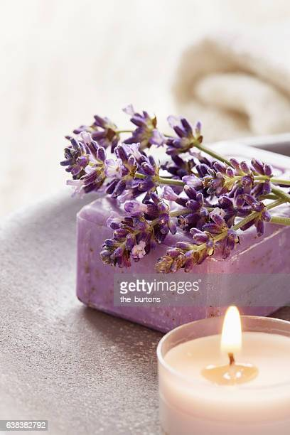 Lavender flowers with soap and candle, aromatherapy
