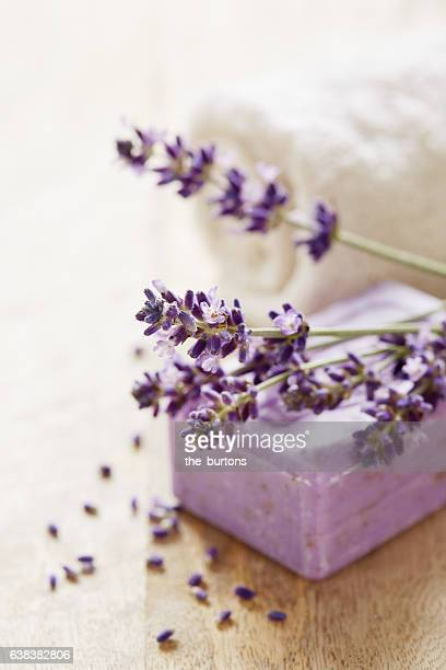 Lavender flowers with soap and towel, spa still-life