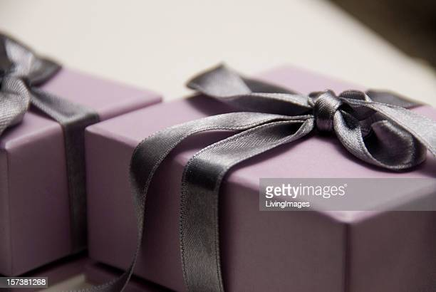 Lavender gift box with a dark purple satin bow